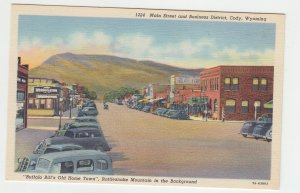 P2050 vintage postcard old cars stores main st cody wyoming rattlesnake mt view