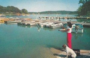 KANSAS CITY , Kansas , 1950-60s ; Park , dog & woman fishing