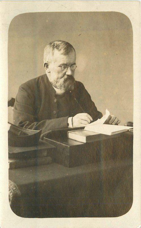 C-1910 Man letter writing Books Desk RPPC real photo postcard 12723