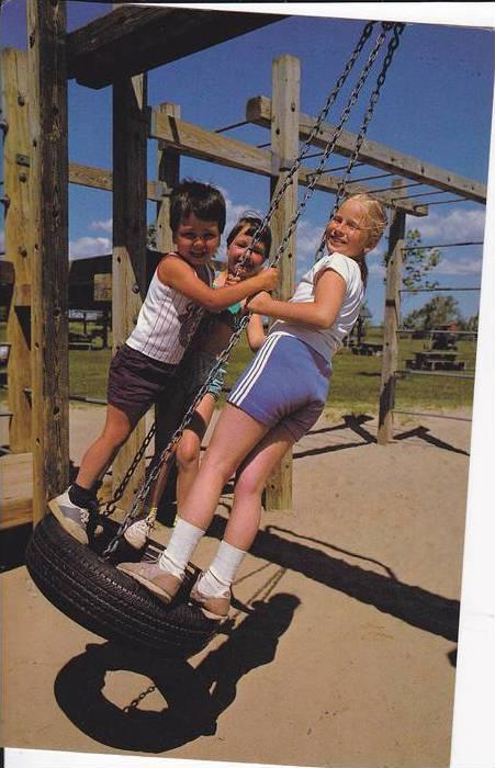 Children Playing With A Tire, Les Enfants Au Parc, Province De Quebec, Canada...