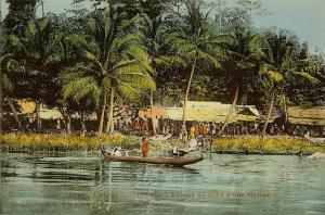 1920 French West Africa Postcard: Small Village on a Riverbank