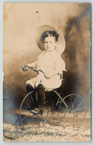 RPPC~Closeup of Toddler on a New Tricycle~Studio Shot~Real Photo Postcard~c1910