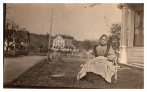 Grandmother sitting Outside Home RPC