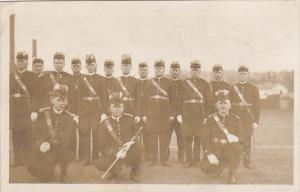 Military Soldiers With Swords Posing In Uniform Photo