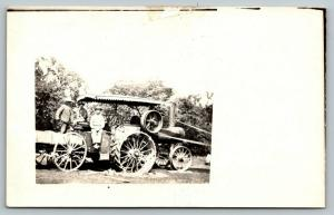 Real Photo Postcard~Farmer Shovels Coal into Steam Tractor~Giant Pulley~c1908