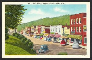 Sylva NC Main Street Looking West with Stores and Cars 1940s-50s Linen Postcard