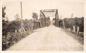 Scottville MI~Riding a Bike Across the Pere Marquette River Bridge~RPPC 1930