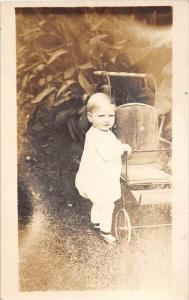 Baby Portrait, standing next to carrige, RPC