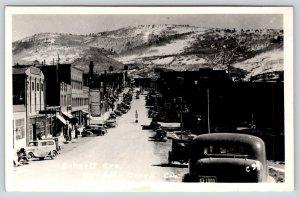 Cripple Creek CO~Bennett Avenue Garage~Gas Pumps on Sidewalk~1930s Cars~RPPC