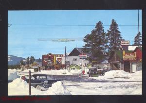 WEST YELLOWSTONE MONTANA DOWNTOWN STREET SCENE WINTER SNOW OLD POSTCARD