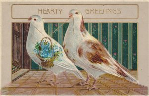 HEARTY GREETINGS; White Doves Carrying A Small Basket Full Of Blue Flowers