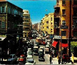 CI01325 lebanon beirut weygand street old cars buses shops advertising