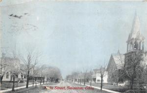Swanton Ohio~Main Street~Church on Right~1911 Blue Sky Postcard