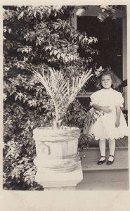 RP: SANTA ROSA , California , 00-10s ; Girl & Plant portrait