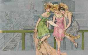 Young ladies reading a letter sitting on pier railing, 1901-07