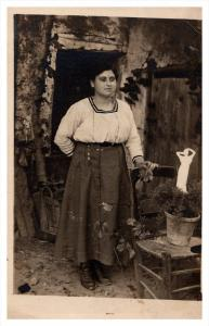 Spanish Woman , standing in Yard ,  RPC