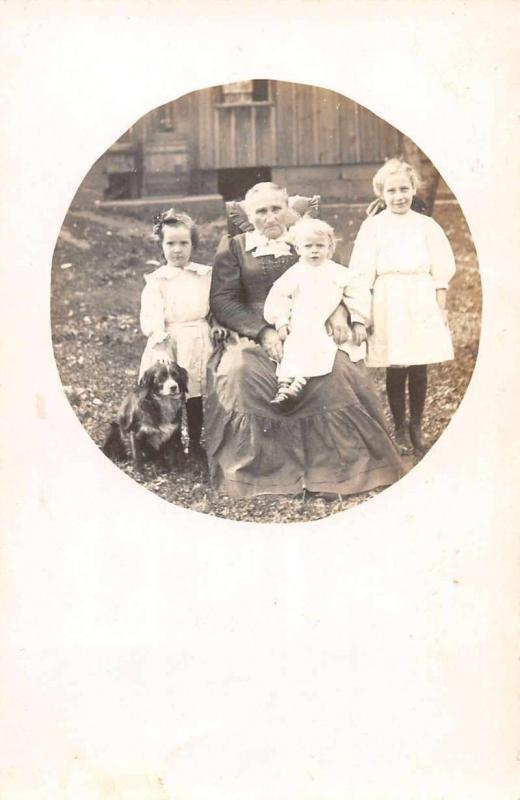 Old Woman with Chilren and Dog Real Photo Antique Postcard J46310