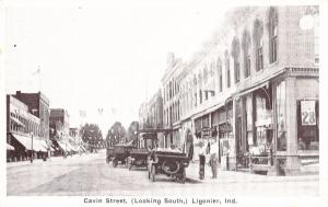 Ligonier IN Cavin Street Business District Storefronts Old Cars Postcard