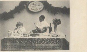 2 children at Holiday Meal , 1901-07