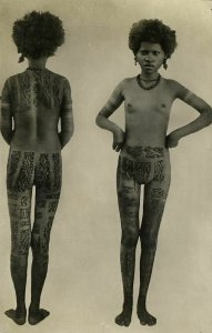 Skinny Nude Native Girl of Unknown Origin with Full Body Tattoo (1920s) RPPC