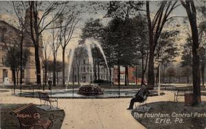 Erie Pennsylvania~Central Park Fountain~Man Sitting on Bench~Church Bknd~1910 Pc