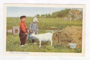 Two Volendam children & goat, Netherlands, 1910s