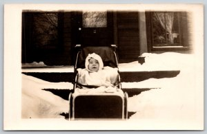Real Photo Postcard~Bundled Up Baby in Buggy~Outside in Snow~Front Porch~c1910