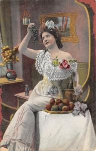 Woman holding grapes and wine Unused
