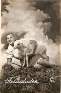 Pretty lady with lamb in the field Nice vintage Spanish postcard