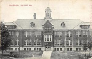 Rice Lake Wisconsin~High School Building~Small Trees in Yard~1911 Postcard