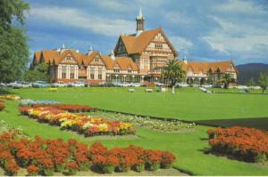 The Tudor Towers Rotorua NZ New Zealand Government Gardens Old Cars Postcard D22