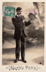 Elegant man early greetings postcard France