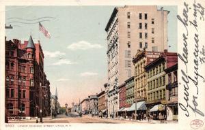 Utica New York~Lower Genesee Street~Storefronts~Trolley on Bridge?~1905 Postcard