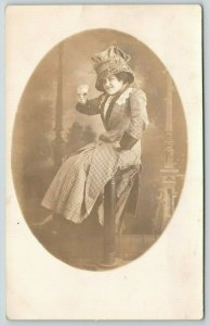 Real Photo Postcard~Little Woman on Pedestal Holds Teacup~Floppy Hat~c1910 RPPC