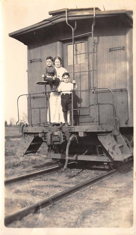 Real Photo~Victorian Mother~Train Caboose Platform~2 Boys~Railroad Tracks~c1912