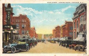 E3/ Carthage New York NY Postcard 1930 State Street Automobiles Stores