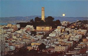 Majestic Coit Tower shines brightly over San Francisco on a moonlight night
