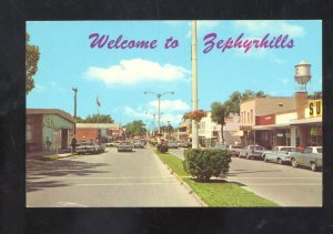 WELCOME TO ZEPHYRHILLS FLORIDA DOWNTOWN STREET SCENE OLD CARS POSTCARD