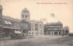 E75/ Woodsfield Ohio Postcard Monroe County West Side Main St c1910   19