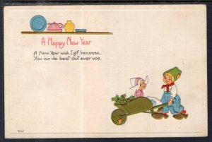 Happy New Year,Dutch Boy Pushing Wheel Barrow With Girl