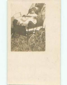 Pre-1917 rppc BABY WEARING WINTER HAT IN ANTIQUE CARRIAGE STROLLER o2374