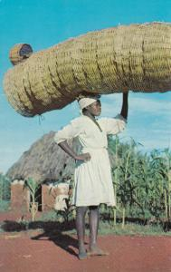 HAITI, 40-60s; Ti-Tantine, Basket Vendor carrying merchandise on head on way fro