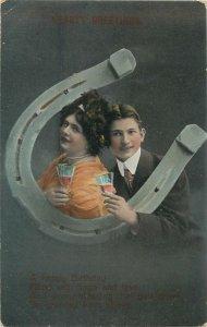 Postcard couple romantic lovers love idyll kiss romance fancy fashion horseshoe