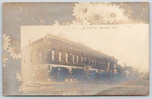 Dexter Iowa~Main Street~Marston Hardware Store~Art Nouveau Daisies~c1910 RPPC