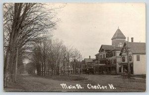 Chester Vermont~Main Street~Drug Store~Hotel~Homes~Dirt Road Median~c1912 RPPC