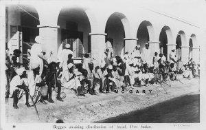 1936 Port Sudan Sudan Real Photo Postcard: Beggars Await Bread Distribution