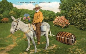 ​Vintage Postcard A Texas Waterworks Of Yesterday Donkey Pulling Barrel