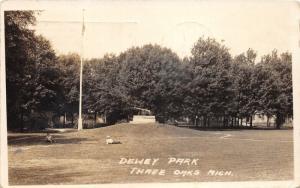 Three Oaks Michigan~Dewey Park~Boys Laying on Grass~Cannon/Flag Display~'23 RPPC