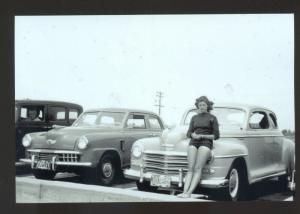 REAL PHOTO 1947 STUDEBAKER CAR DEALER ADVERTISING POSTCARD PRETTY WOMAN COPY