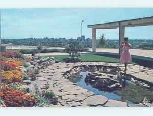 Pre-1980 WOMAN IN PINK DRESS TAKES TOURIST PICTURE AT POOL Calgary AB F8596